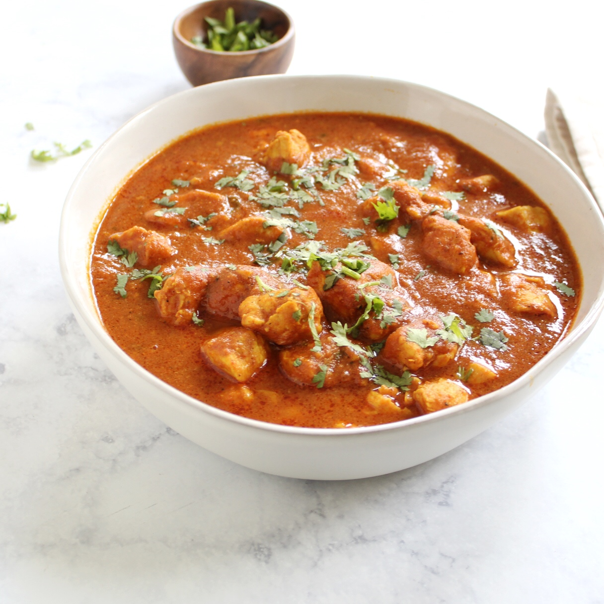 Chicken curry in serving bowl